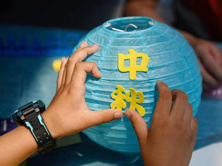 Children take part in activities to celebrate Mid-Autumn Festival across China