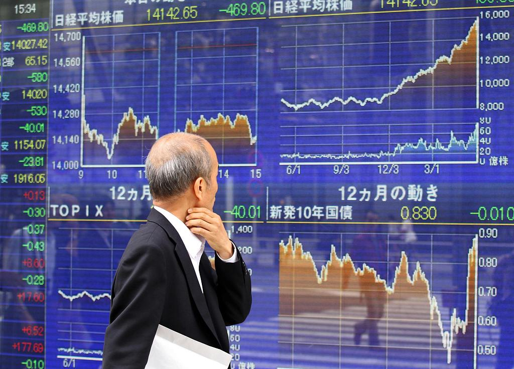 Tokyo stocks open lower as investors await outcome of Fed meeting