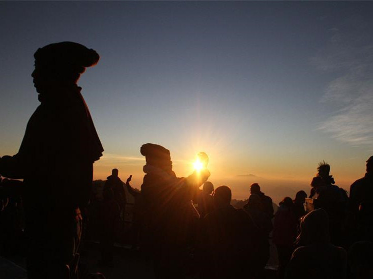 People enjoy view of sunrise at Mount Bromo in East Java, Indonesia