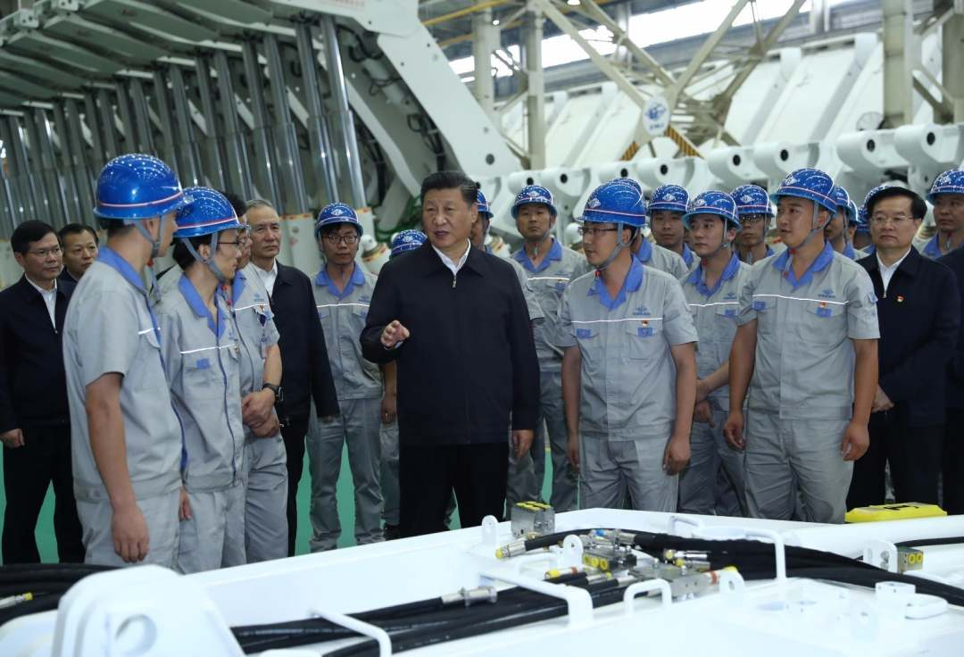 Xi stresses development of real economy in tour to central China