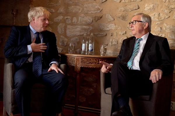 UK PM awaits judgement on parliament prorogation as EU's Juncker says Brexit deal possible