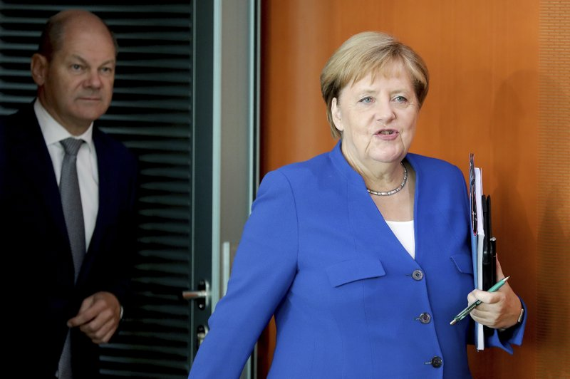 German govt reaches 100 bn euro climate plan deal as protests heat up