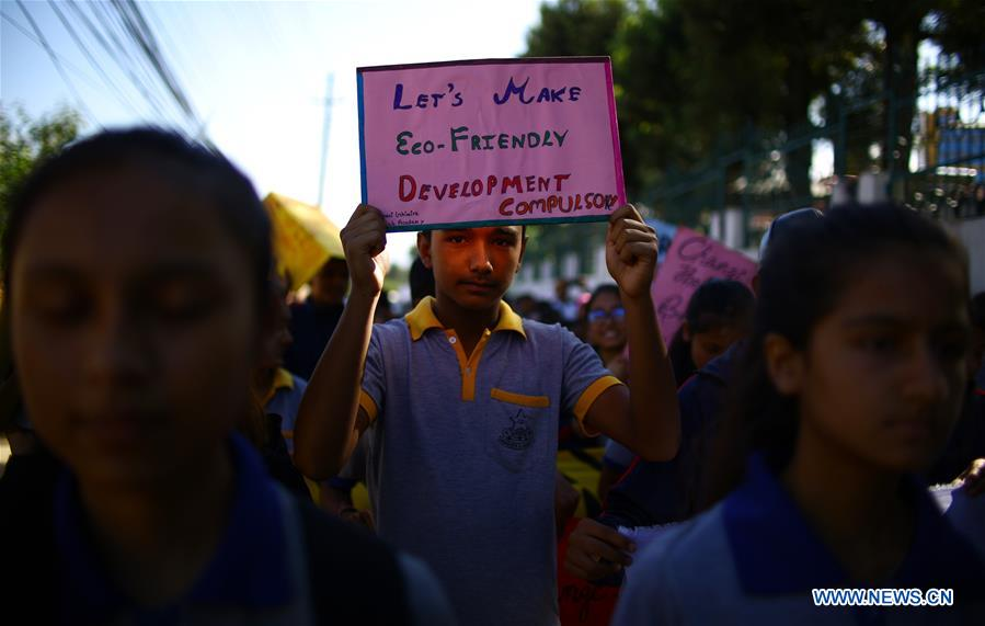 Students rally to call for actions against climate change in Kathmandu