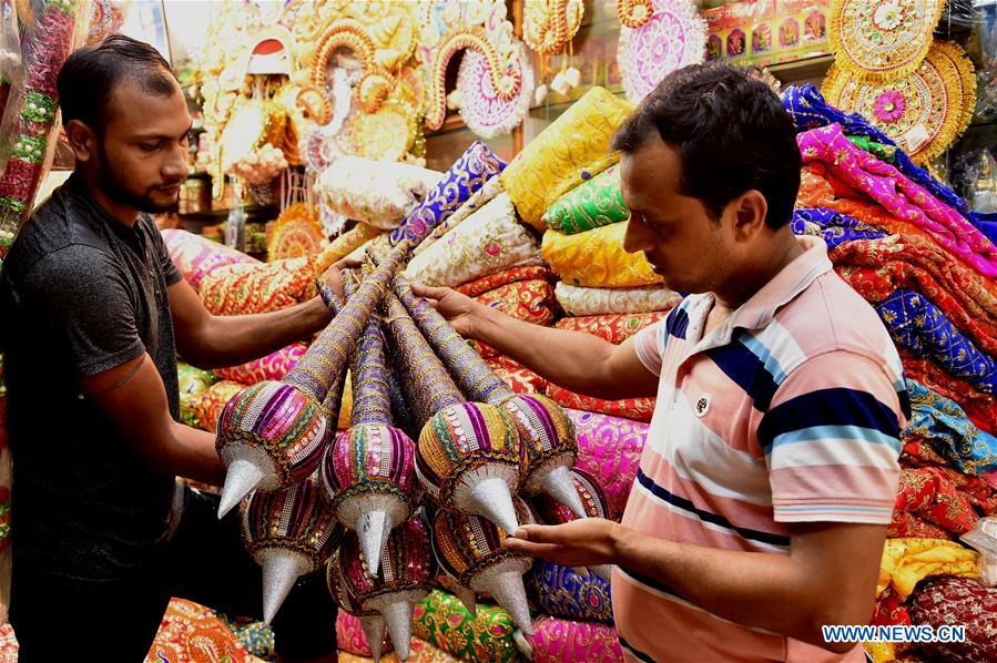 People in Dhaka prepare for annual Durga Puja festival