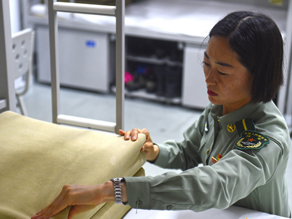 Female Chinese soldiers prepare for the National Day military parade