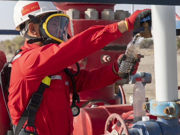 Oil workers at Shunbei oil-gas field in Xinjiang