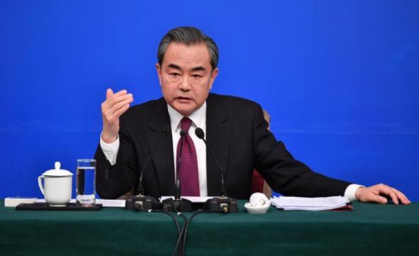 China not fazed by threats or pressure: Wang Yi