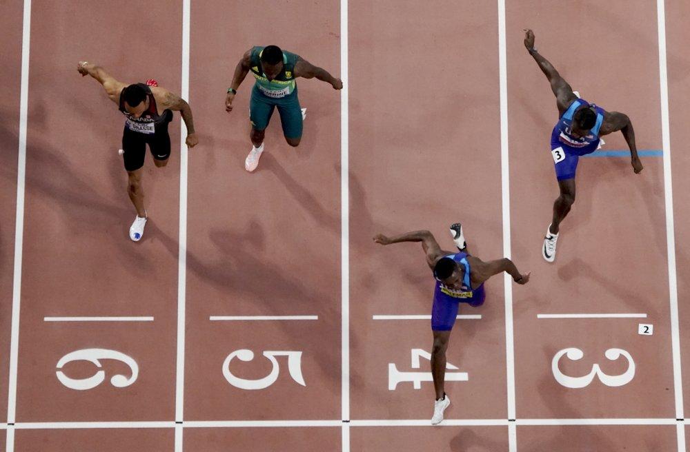 American Coleman wins world 100m gold