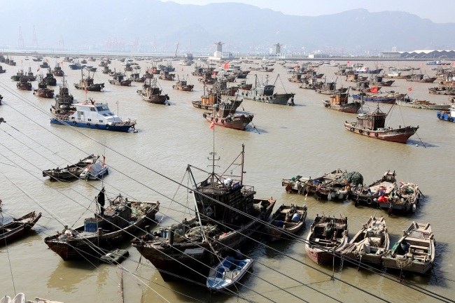 China issues yellow alert for Typhoon Mitag