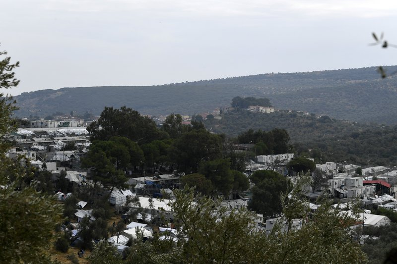 Migrants in Greece set fires at camp; 2 deaths reported