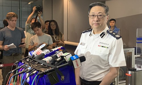 Officer fires shot at rioter in self-defense: HK police chief
