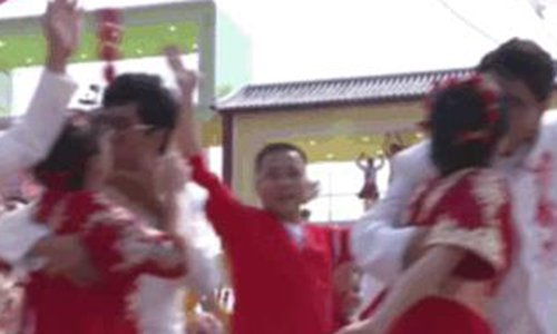 Young couple's kiss at National Day parade a hit on Chinese social media