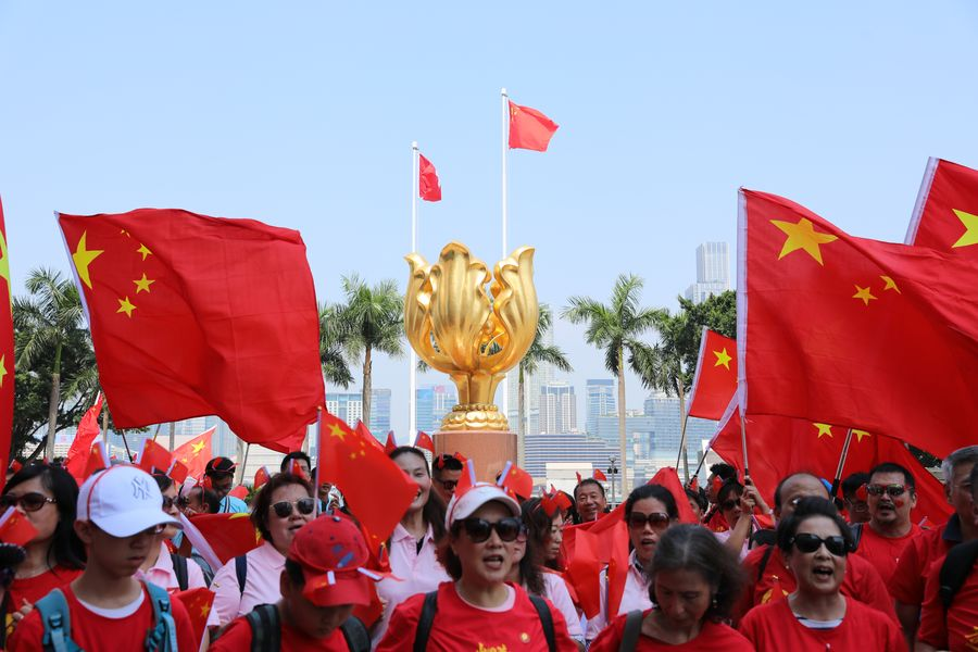 Hong Kong residents celebrate National Day with flags, songs, sports