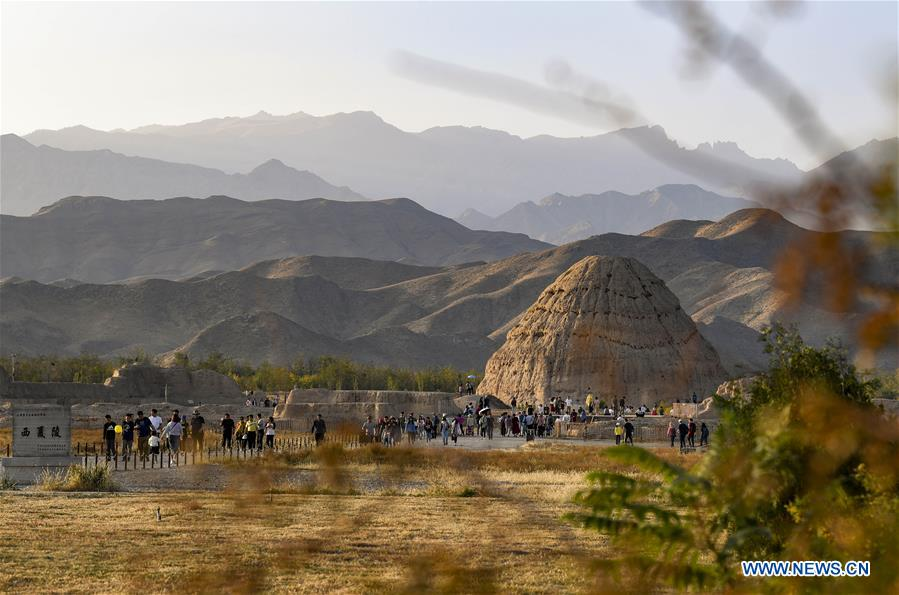 Tourists visit imperial tombs in China's Ningxia during National Day holiday