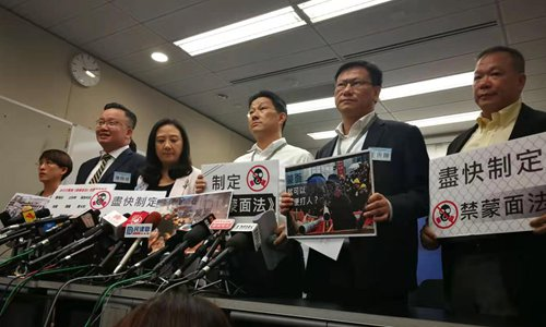 HK lawmakers urge Lam to pass anti-mask law