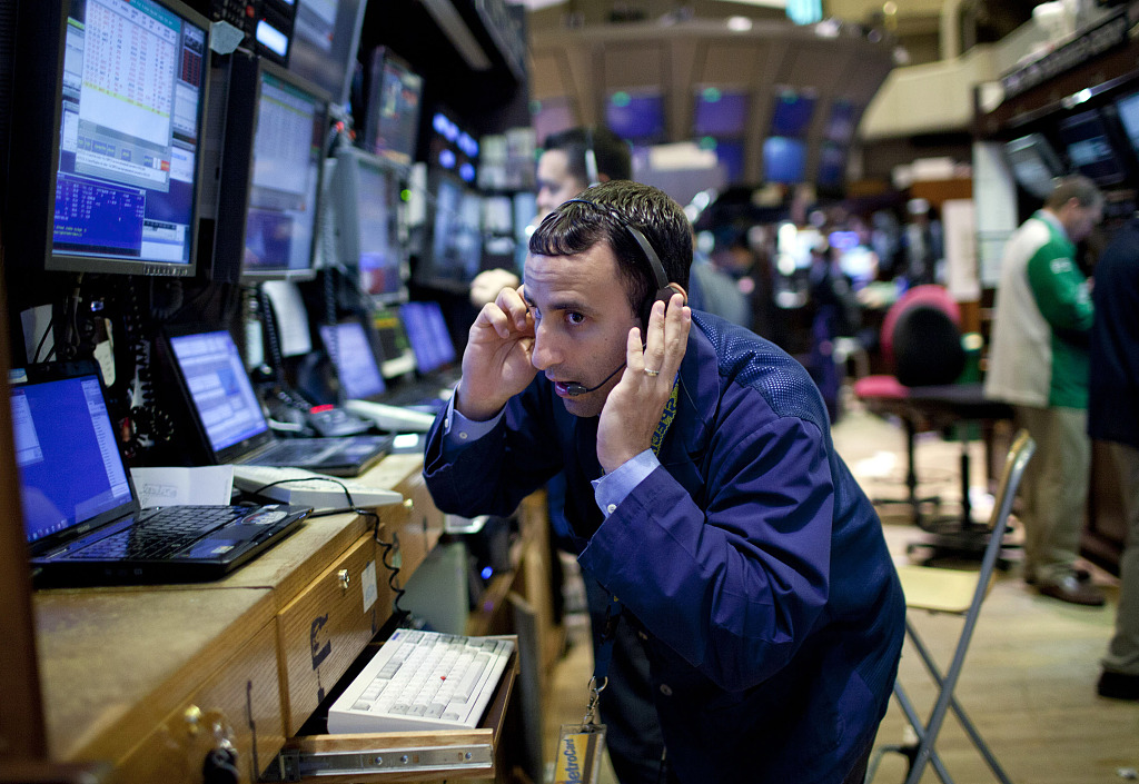 Global markets tumble on US data, trade concerns