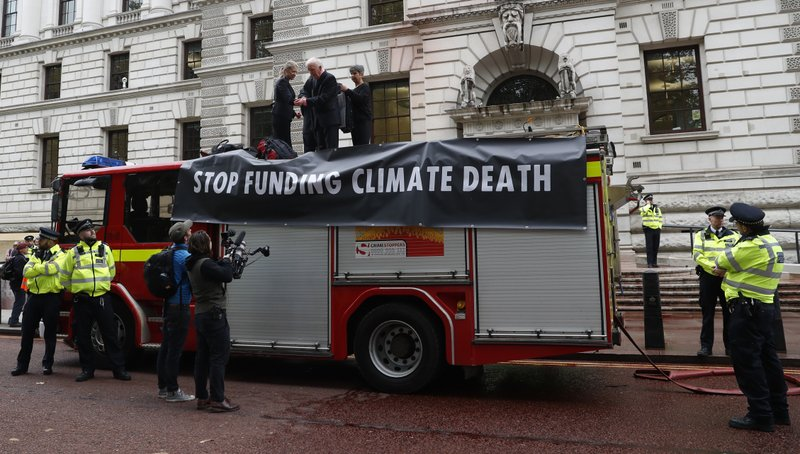 Climate activists spray fake blood on UK government building
