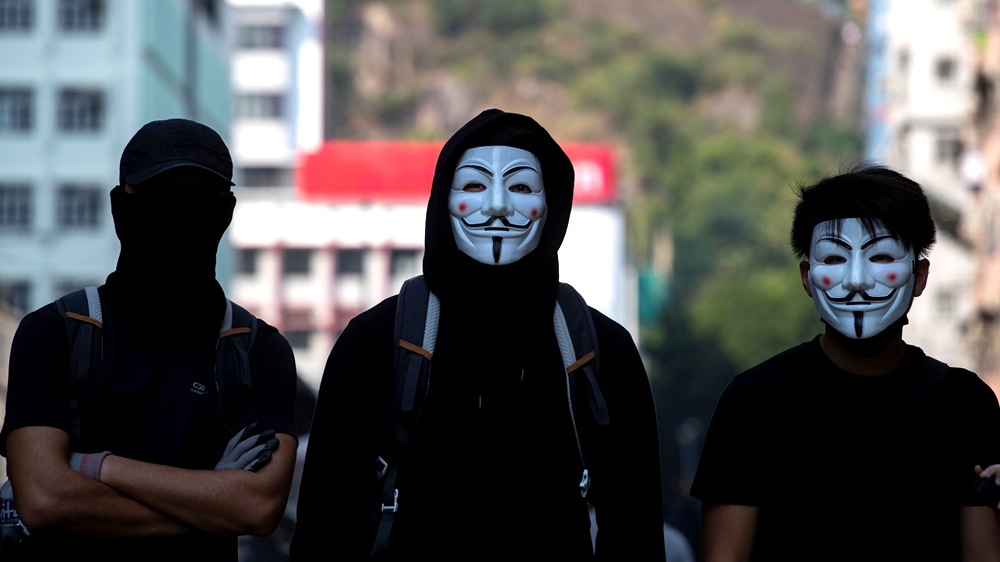 Roundup: Hong Kong's anti-mask law a necessary move for social stability, experts say