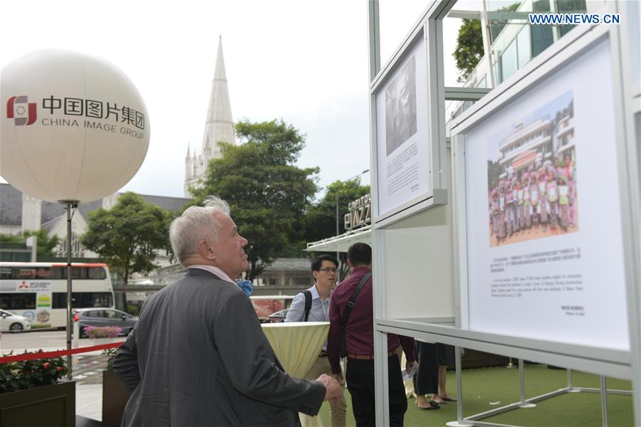 Educational photo exhibition opens in Singapore