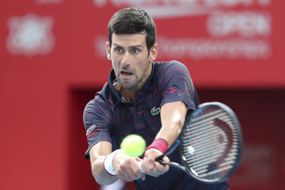 Djokovic beats Millman in straight sets to win Japan Open