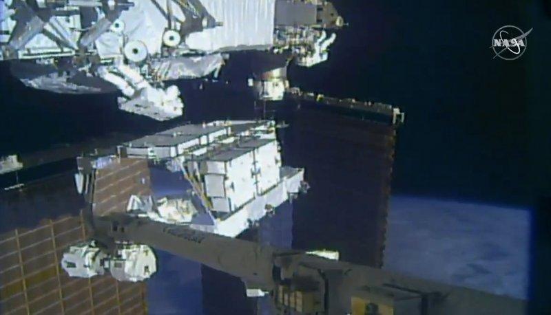 Astronauts replacing old batteries in 1st of 5 spacewalks