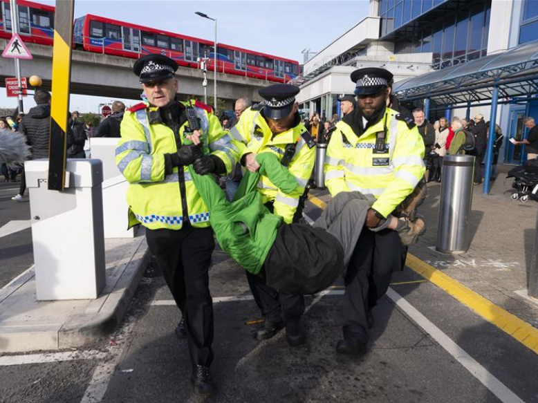 Extinction Rebellion protestors arrested by police at City Airport in London