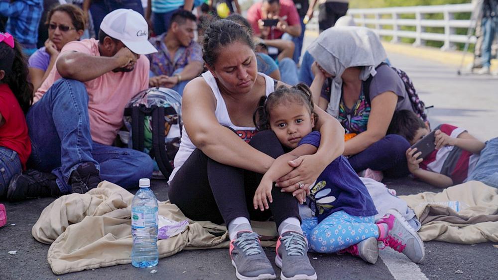 Migrant protesters occupy US-Mexico border bridge, crossing closed