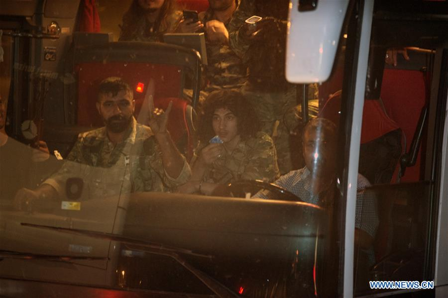 Members of Syrian National Army head for Akcakale in southern Turkey