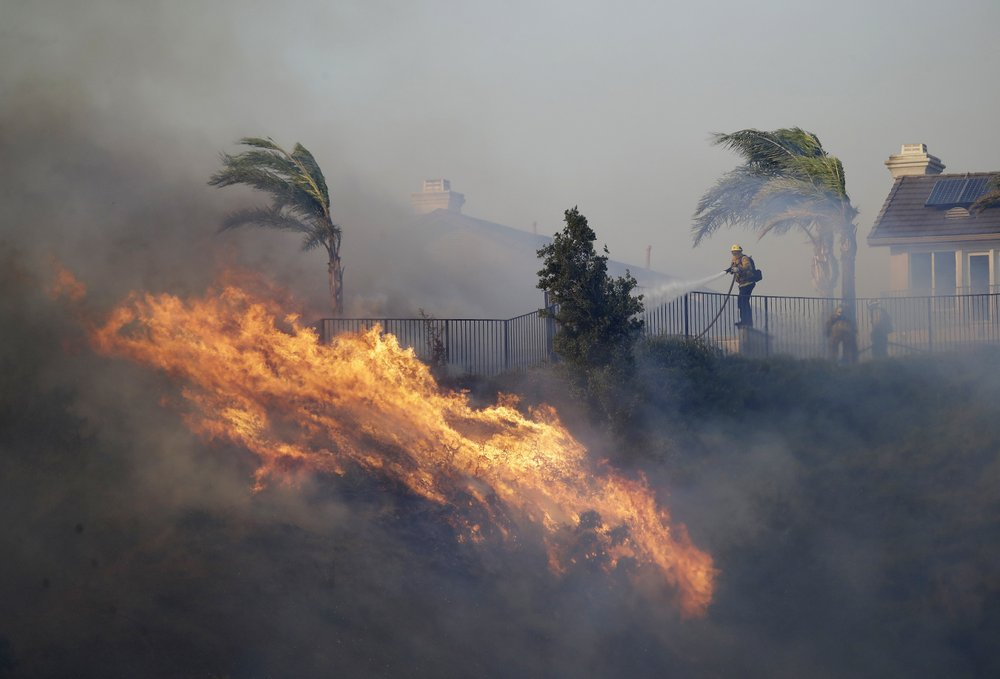 Fast-moving fire drives thousands from California homes