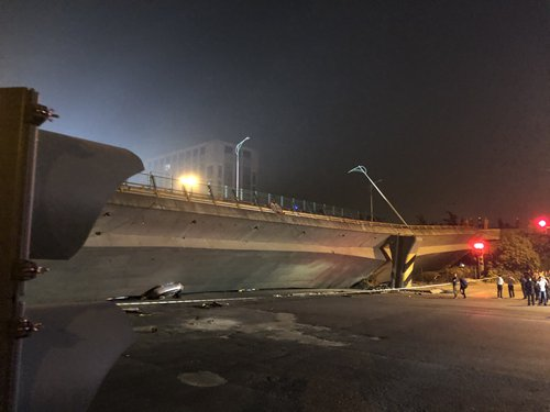 Police probe overloading after 3 killed in overpass collapse