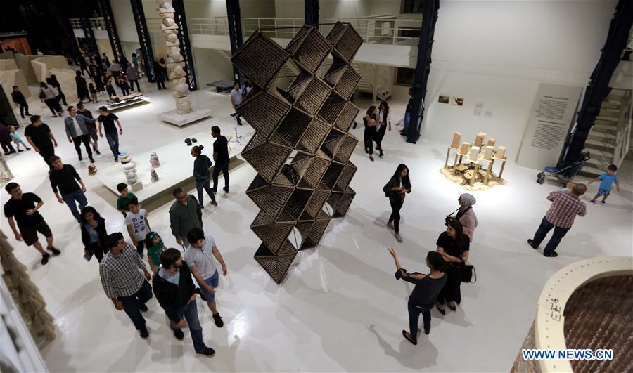 Visitors view artworks during Amman Design Week 2019
