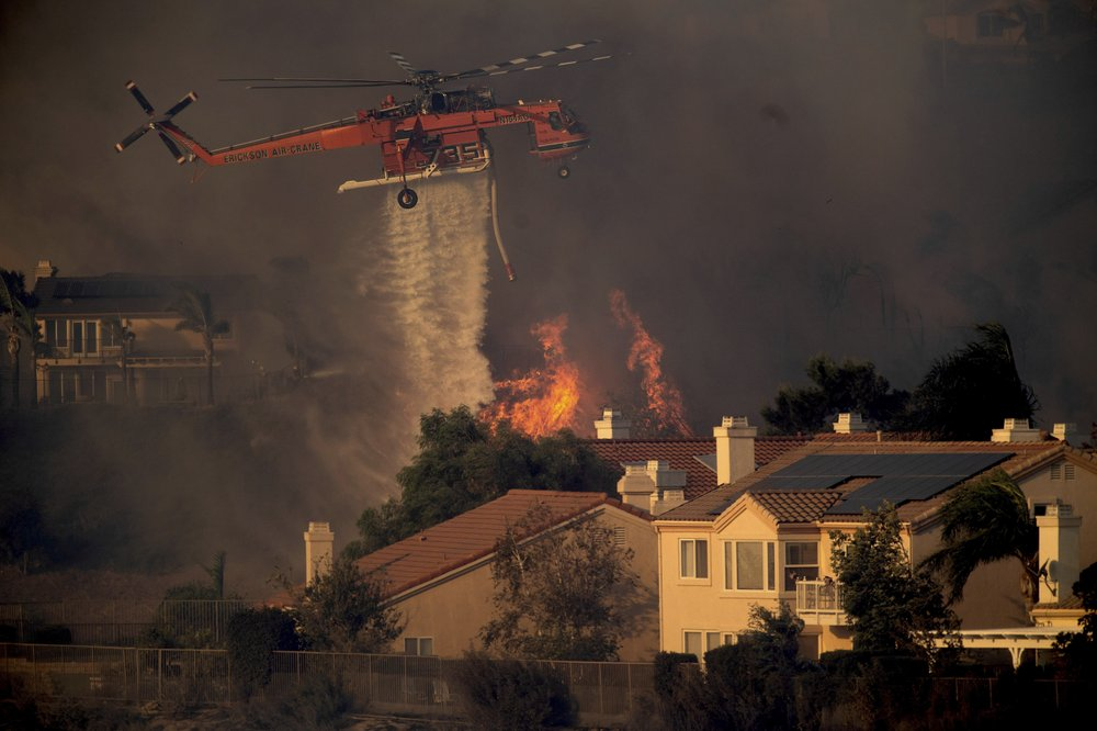 California continues to battle wildfires as officials warn residents of heavy smoke