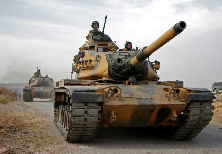 Syria Kurds defend key town as Turkey ignores US