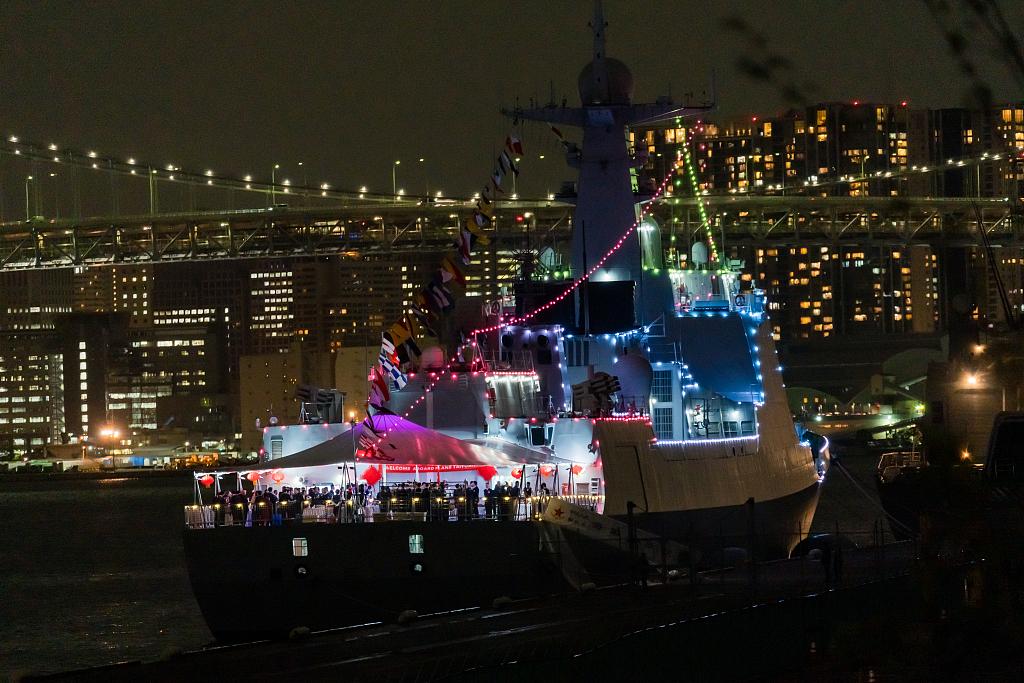 Chinese Navy destroyer illuminates Tokyo pier