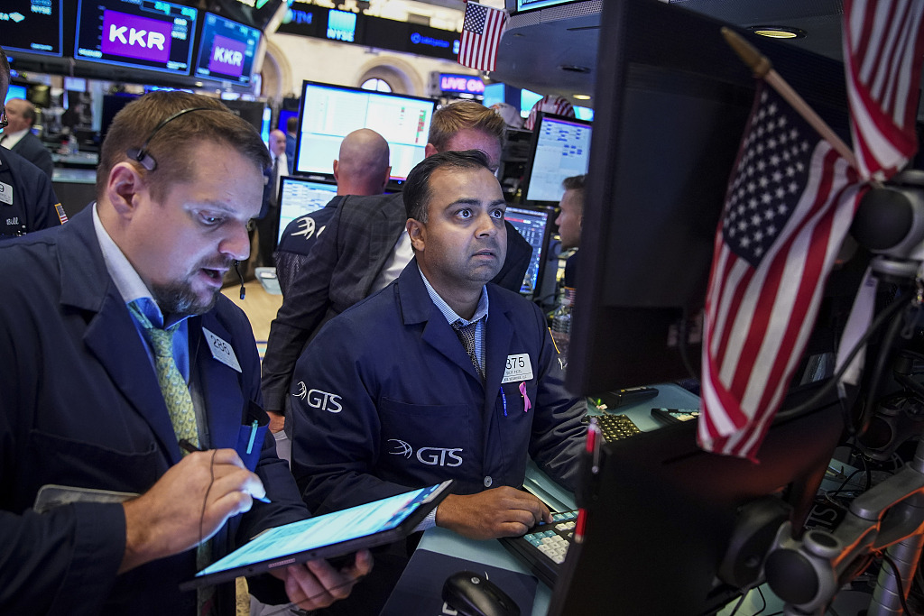 US stocks close higher amid corporate earnings