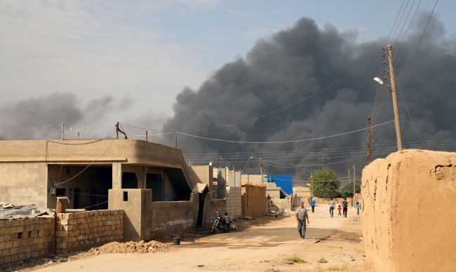Kurdish forces fully withdraw from besieged Syria town: monitor