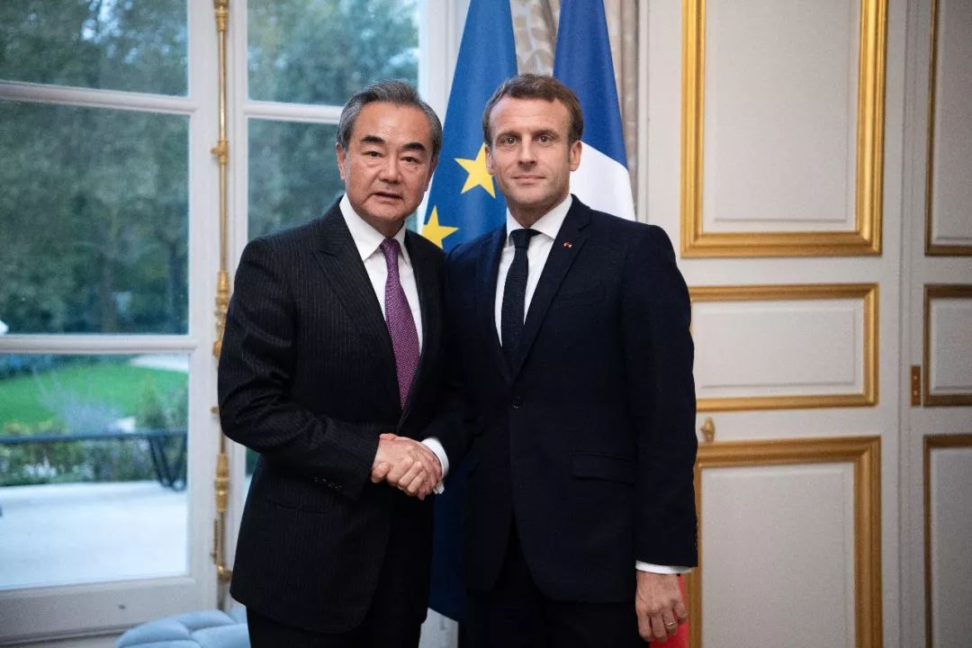 French president meets Chinese FM on ties