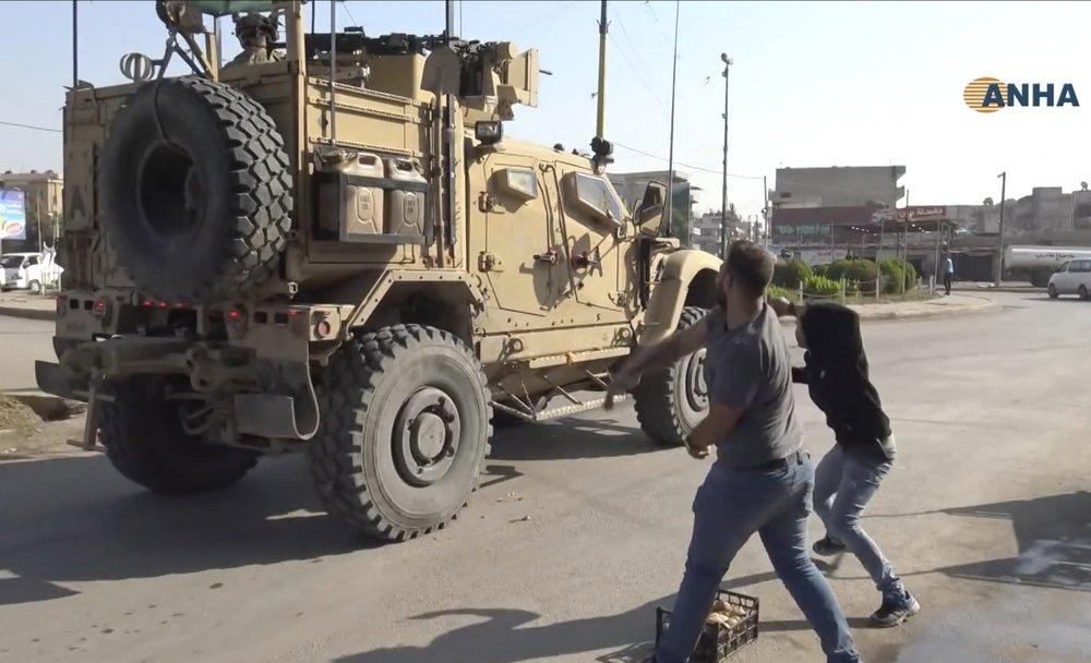 Residents of northeast Syria city pelt departing US troops