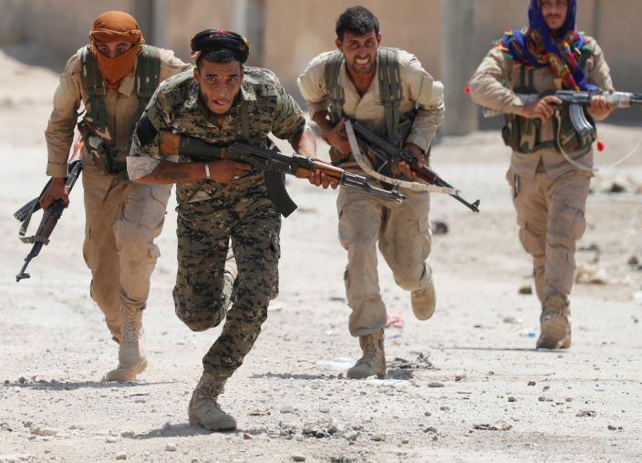 Nearly 800 Kurdish fighters leave N. Syria under cease-fire deal: Erdogan