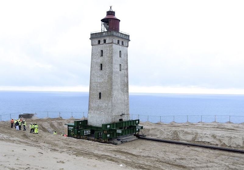 Danes move 120-year-old lighthouse back from eroding coast