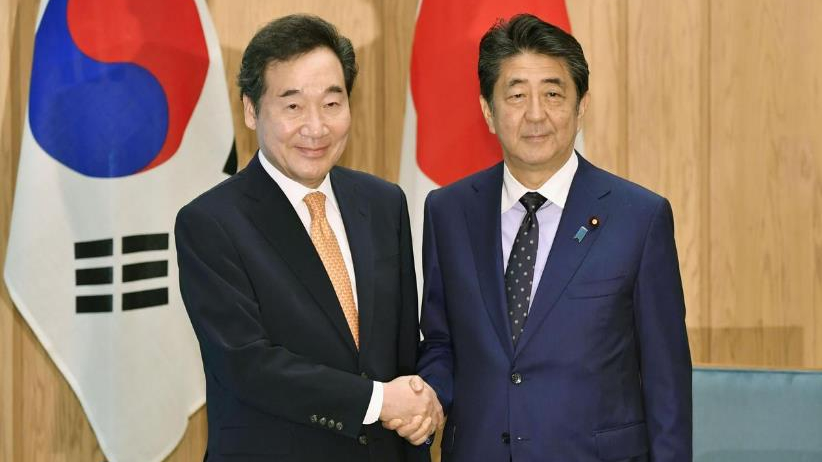 Japan's Abe, South Korean Prime Minister Lee meet amid bitter row over history, trade
