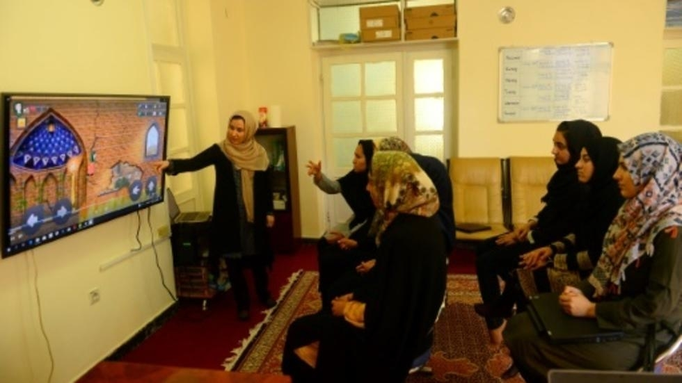 Bored of male heroes, Afghan girl coders build their own champions