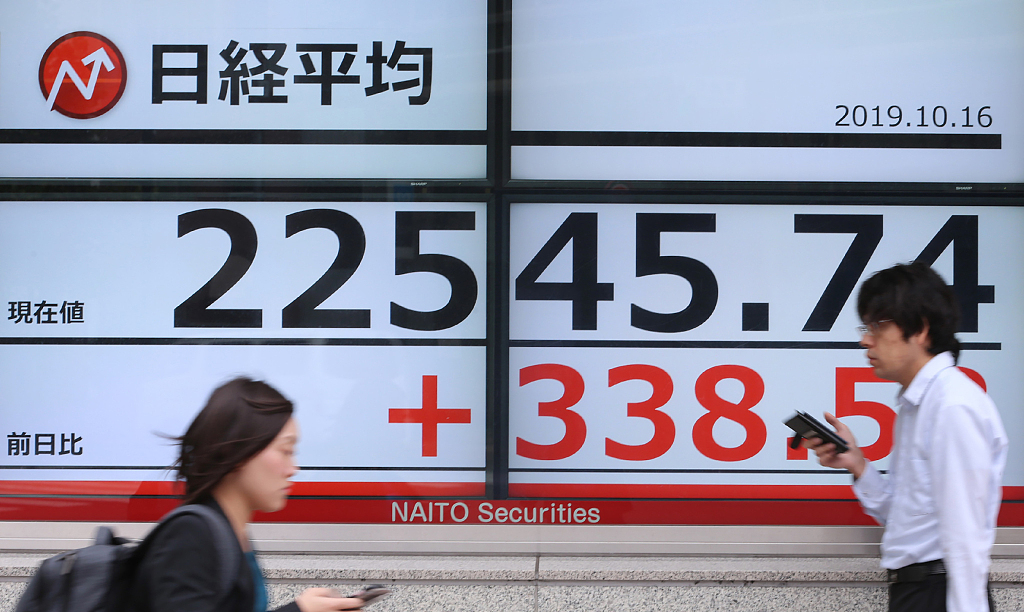 Tokyo stocks close higher as sentiment buoyed by US earnings