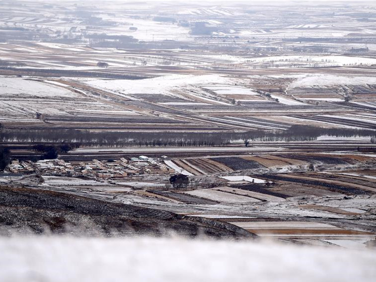 Scenery of snow-covered village houses and fields in China's Inner Mongolia