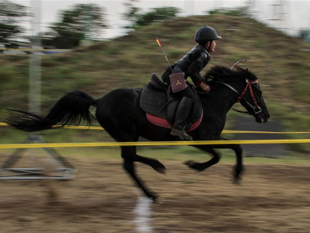 Traditional horseback archery tournament held in Malang, Indonesia