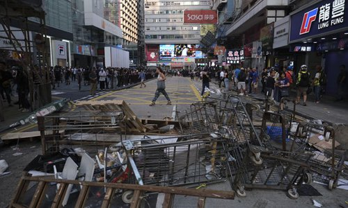 Hong Kong sees another weekend of violence as protesters paralyze traffic, attack police officers