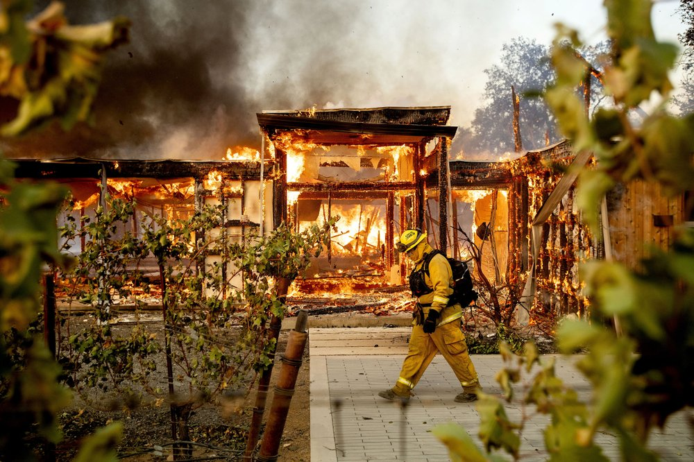 California declares state of emergency over wildfires, winds