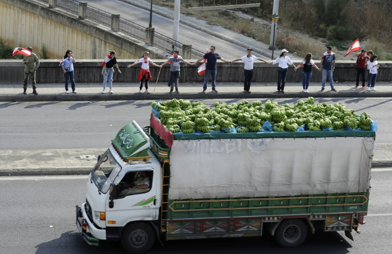 Lebanon protesters start forming nationwide human chain