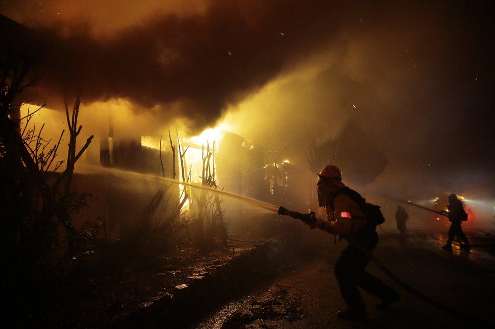 California wildfires erupt in LA, burn in wine country