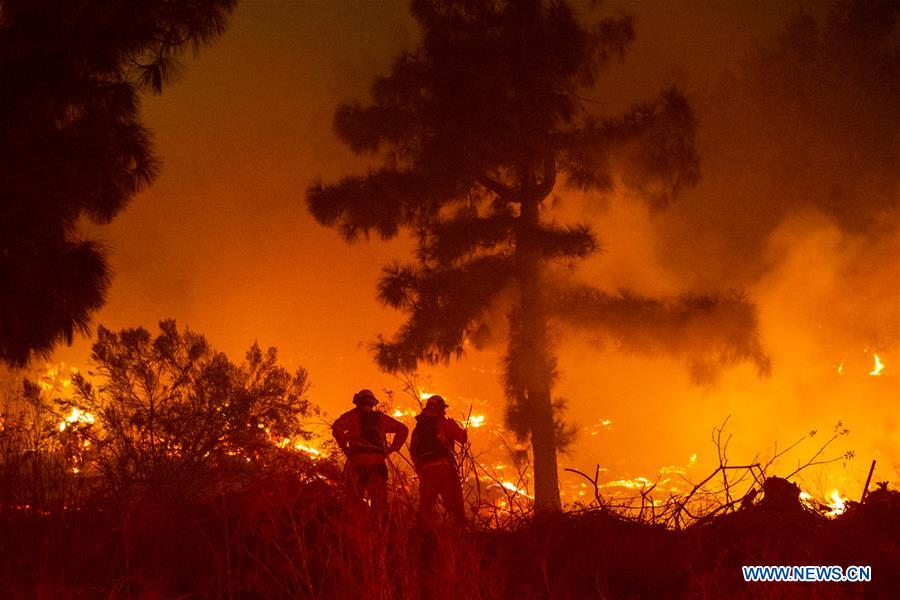 Thousands evacuated in Los Angeles over fast-moving wildfire near Getty Center